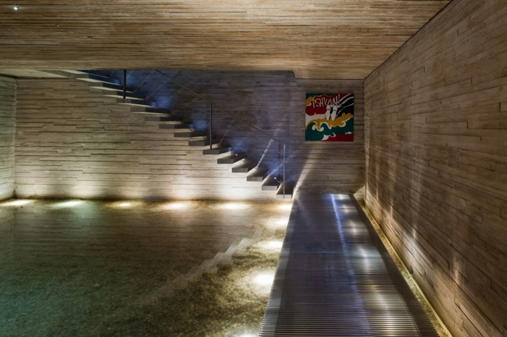 floating stairs in the Minimalist Modern Beach House in the Wilderness- Paraty House by Marcio Kogan