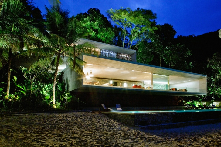 breathtaking view at nigh Minimalist Modern Beach House in the Wilderness- Paraty House by Marcio Kogan