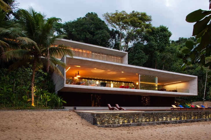 perspective front view of the Minimalist Modern Beach House in the Wilderness- Paraty House by Marcio Kogan