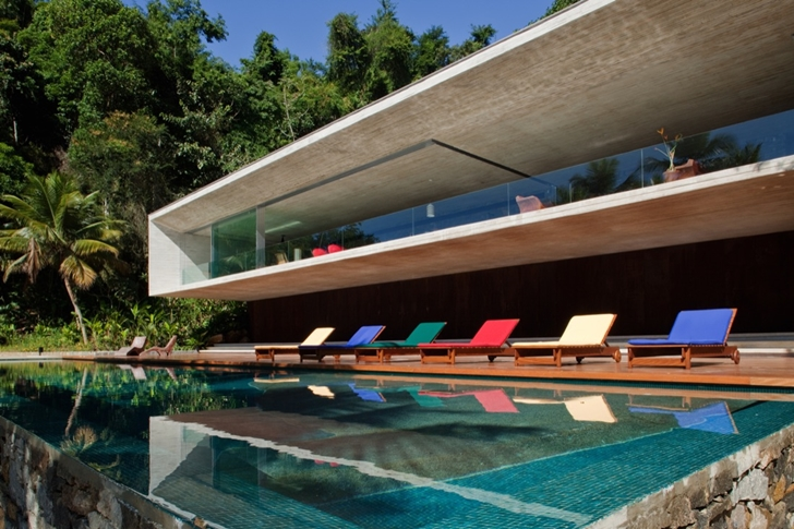 infinity swimming pool patio and terrace Minimalist Modern Beach House in the Wilderness- Paraty House by Marcio Kogan