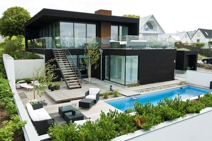 main black facade of the Nilsson Villa-Modern Beach House With Black and White Interior Design in Sweden