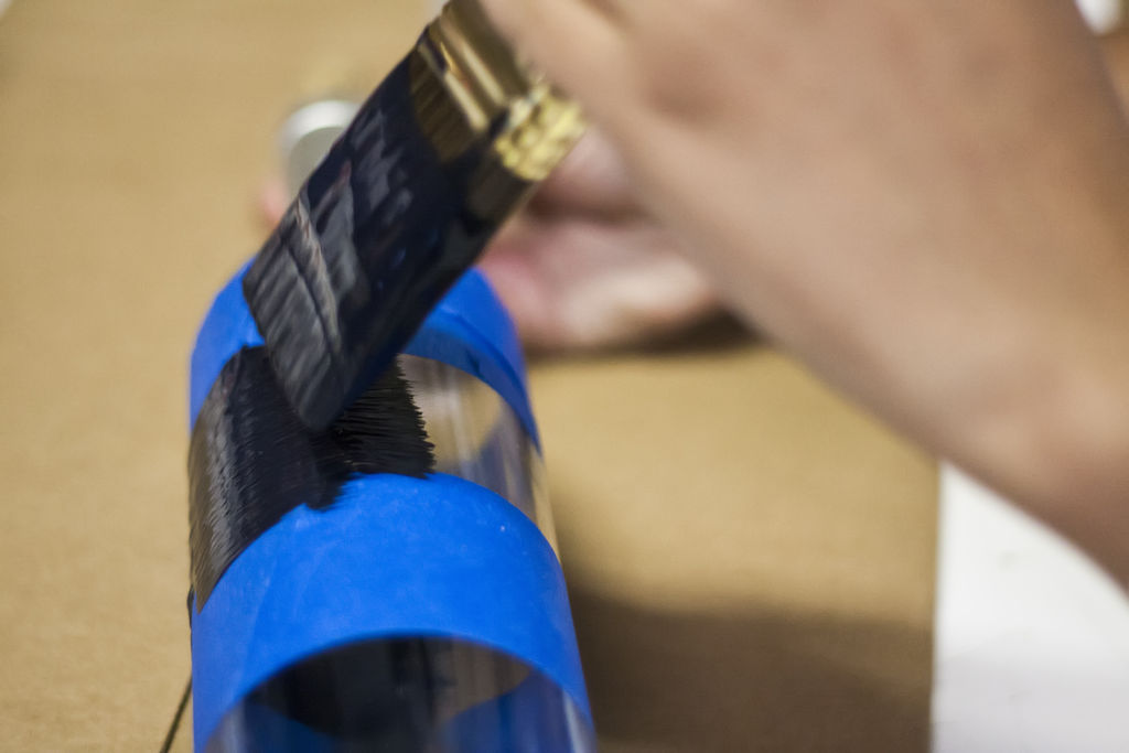 painting the bottle in Recycled Wine Bottles-How to Label or Paint a Bottle with Chalkboard Paint wine botle art (1)