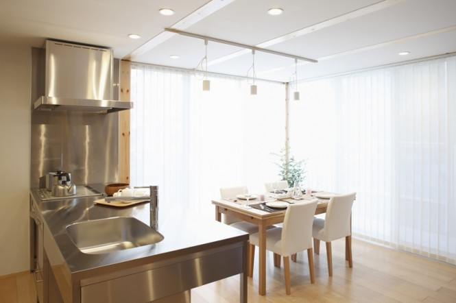 dinning area in Simple Open Plan House Generating Equilibrated Small Spaces by Muji