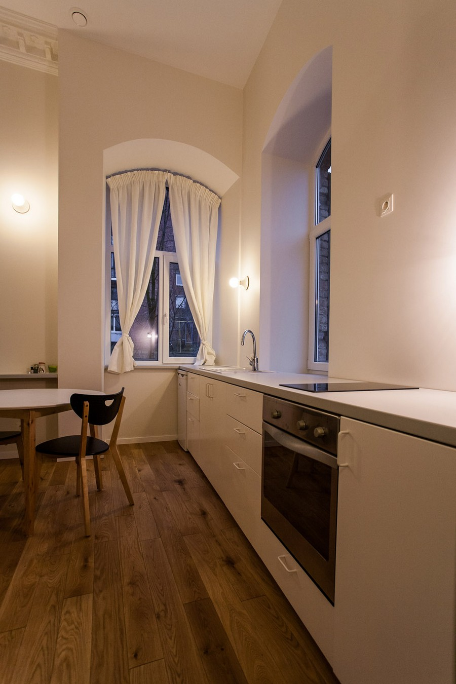 modern kitchen in Small Apartment Design Sheltered by a  Brick Mansion in Vilnius, Lithuania