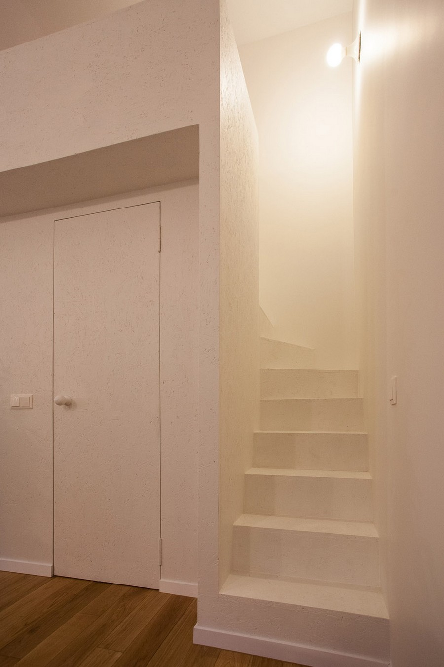 staircase within Small Apartment Design Sheltered by a  Brick Mansion in Vilnius, Lithuania