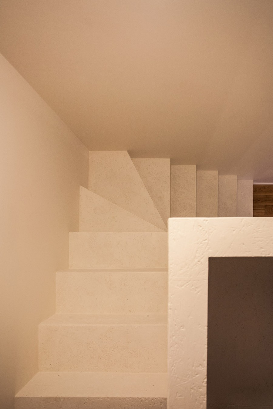 staircase from above Small Apartment Design Sheltered by a  Brick Mansion in Vilnius, Lithuania