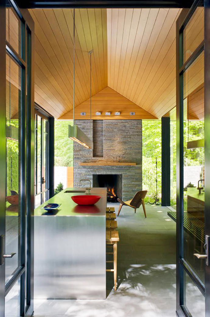 modern fireplace in the Supreme Backyard Landscaping Ideas-Nevis Pool and Garden Pavilion by Robert M. Gurney