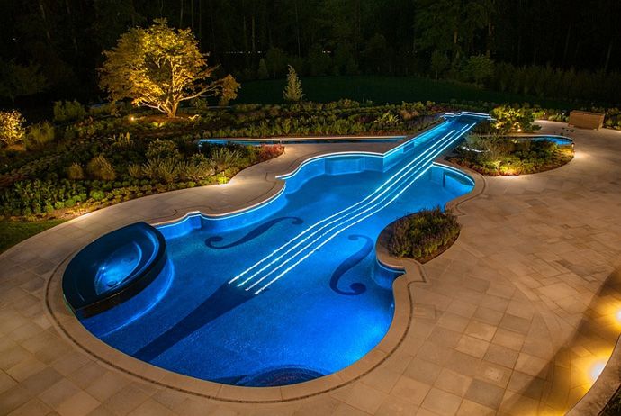 blue Backyard-Landscaping-Ideas-Swimming-Pool-Forged-as-a-Stradivarius-Violin at night