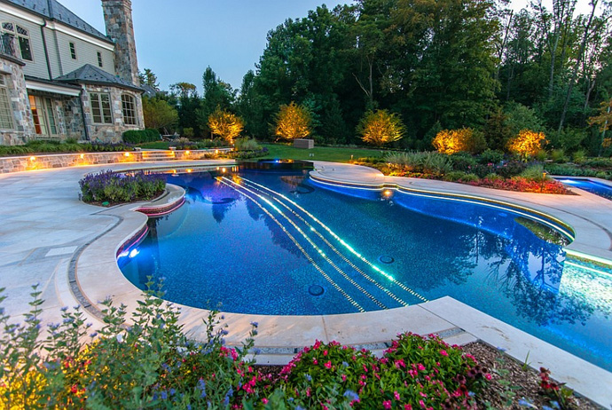 blue and green illuminated Backyard-Landscaping-Ideas-Swimming-Pool-Forged-as-a-Stradivarius-Violin