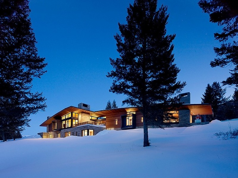 exterior view at night Butte Residence- The Home and Studio of an Artist Enjoying Spectacular Panoramic Views in Wyoming