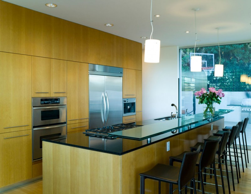 glass kitchen counter in a modern kitchen design Creative-Interior-Design-Nestled-in-a-Modern-Mansion-Defined-by-Open-Spaces-and-Love-for-Nature