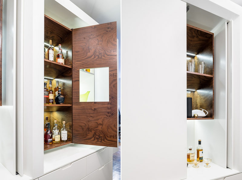 open cabinet of the Modern Small Kitchen Design Idea by MKCA Incorporates Versatility & Functionality