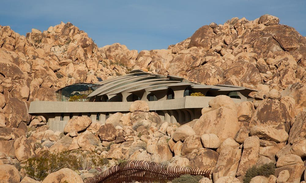 exterior perspective view of the Ribcage-Like-Camouflaged-Joshua-Tree-Supervillain-Lair-Exposed-For-Sale-For-First-Time-homesthetics