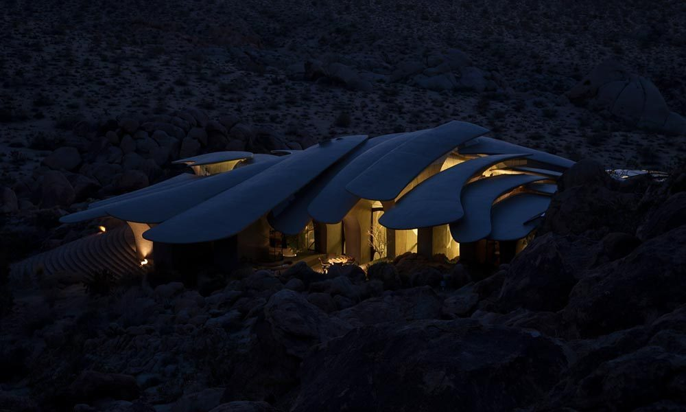 Ribcage-Like-Camouflaged-Joshua-Tree-Supervillain-Lair-Exposed-For-Sale-For-First-Time-homesthetics illuminated at night