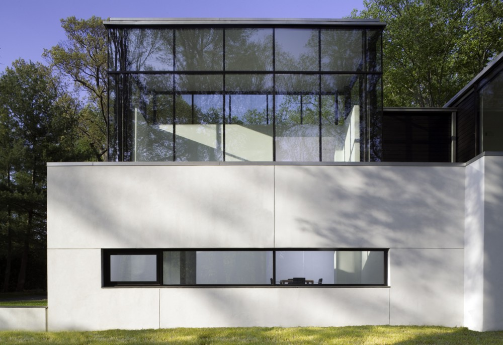 black and white modern mansions in the woods