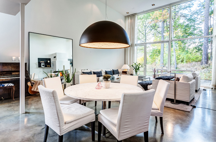 white dinning areaVivid-Interiors-and-Serene-Atmosphere-Produced-with-High-Contrasts-in-Stockholm-by-Franson-Wrelan