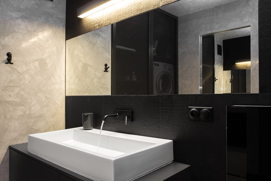 sink in the BoldMasculine-Black-and-White-Apartment-Enhanced-by-Colorful-Details