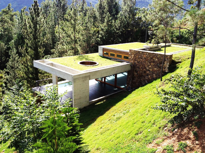 rd house in dominican republic featuring a sustainable green roof