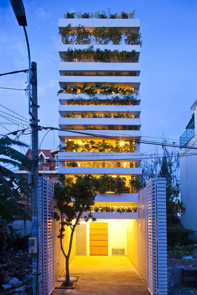 """""""Stacking Green"""" -Small House in Saigon Wearing Green Façades at night"""