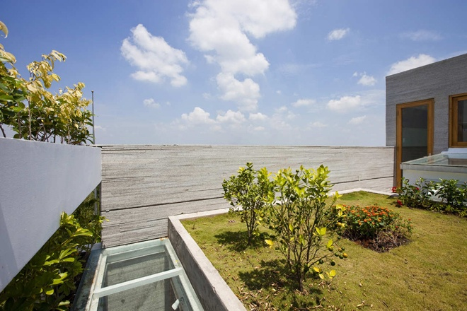 """superb view from the terrace of the """"Stacking Green"""" -Small House in Saigon Wearing Green Façades"""