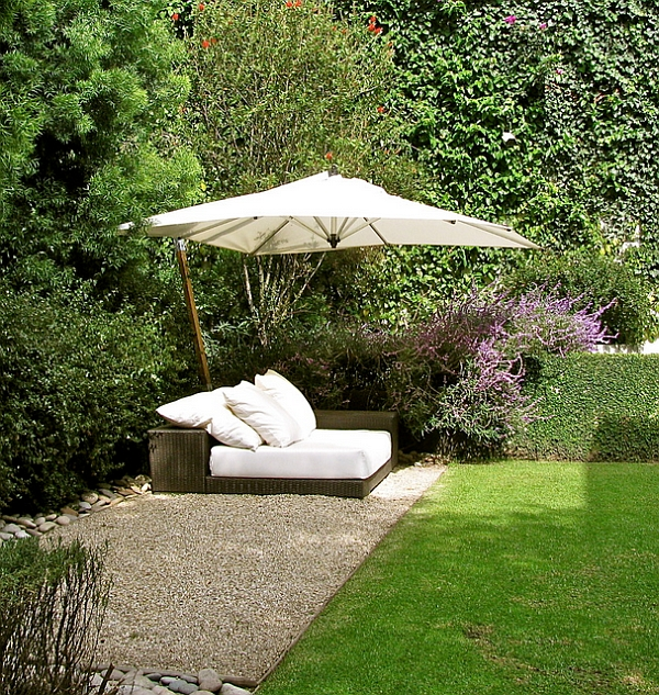 Stylish White Outdoor Bed Protected by a Umbrella in Tropical Style