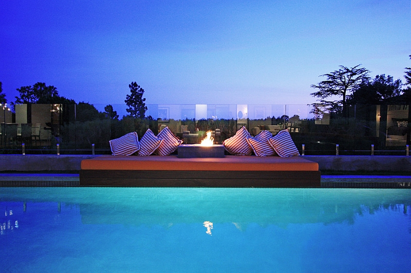 Outdoor Bed by the Pool and Fireplace