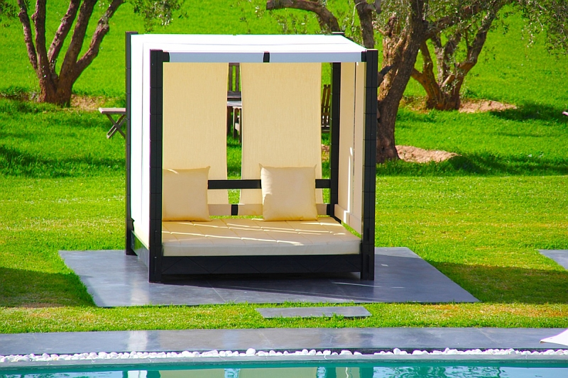 Perfect Cubic Outdoor Bed Complementing The Pool Deck
