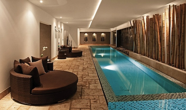 Luxurious Textures Surrounding a Narrow Swimming Pool