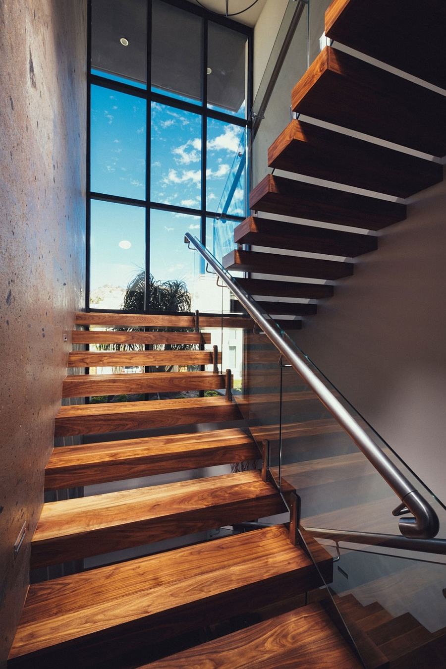 Floating-wooden-stairs-with-a-glass-and-steel-railing-homesthetics