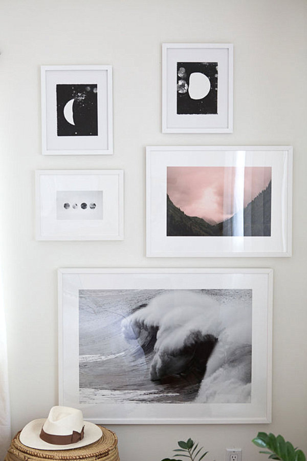 A Small Gallery on the Wall of an Eclectic Bedroom