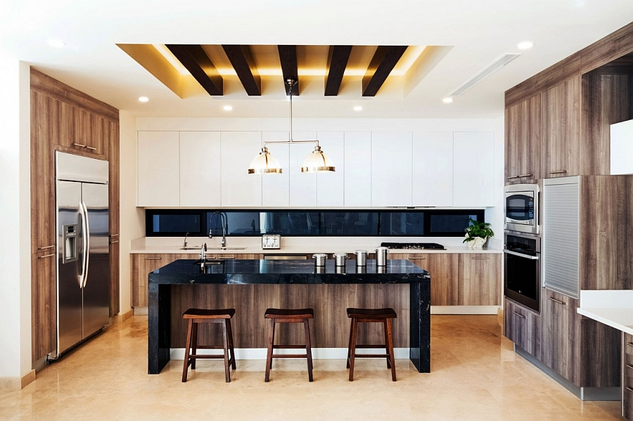 Gorgeous-modern-kiitchen-with-white-cabinets-and-an-island-in-black-stone