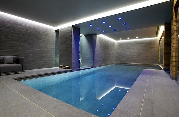Minimalist Indoor Pool Design with Grey Walls and Recessed Lighting