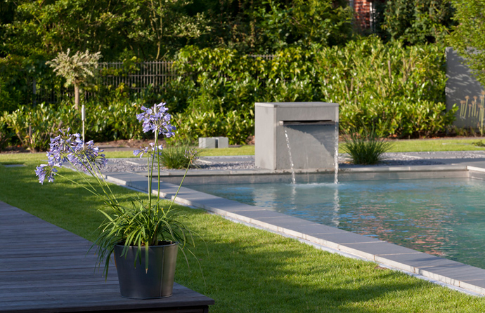 waterfall pouring into the swimming pool