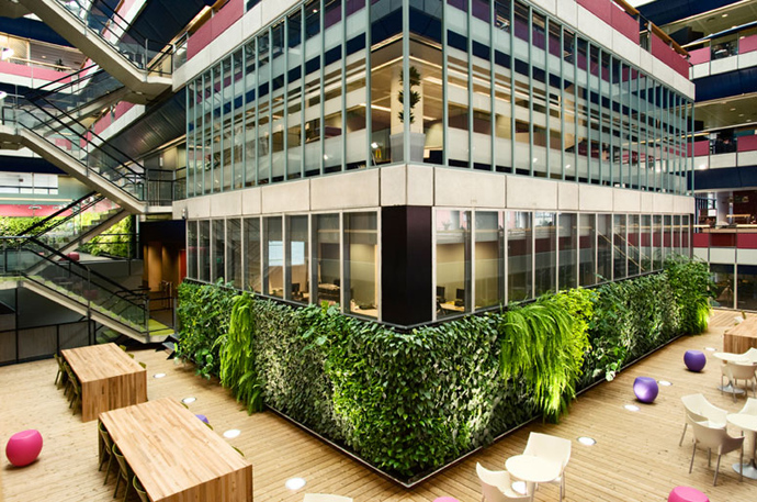 the first floor PlantWalls-–-Greenery-Without-Losing-Floor-Space-Materiallized-by-Green-Fortune