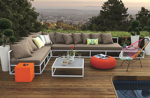 Scenic Outdoor Patio With L-Shaped Couch and Colorful Accents
