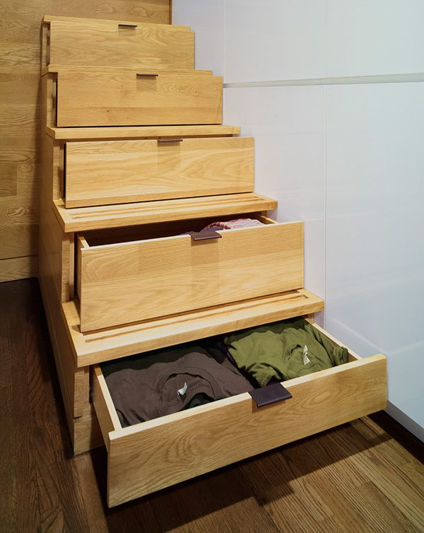 small storage under the stairs Small-Tiny-apartment-Office Renovation-East-Village by JPDA  (1)