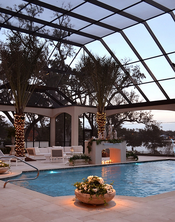 Stylish-screened-enclosure-surrounds-the-pool Lavish Home Swimming Pools Designs on lavish office decorating ideas, inground swimming pool designs, lavish houses exterior designs, tuscan swimming pool designs, back yard swimming pool landscape designs, best swimming pool designs, lavish houses in california, small swimming pool designs, basic swimming pool designs, lavish swim, lavish private pool, lavish style homes, backyard swimming pool designs, lavish master baths, beautiful swimming pool designs, lavish house balcony, rustic swimming pool designs, exotic swimming pool designs, unusual swimming pool designs, freeform swimming pool designs,