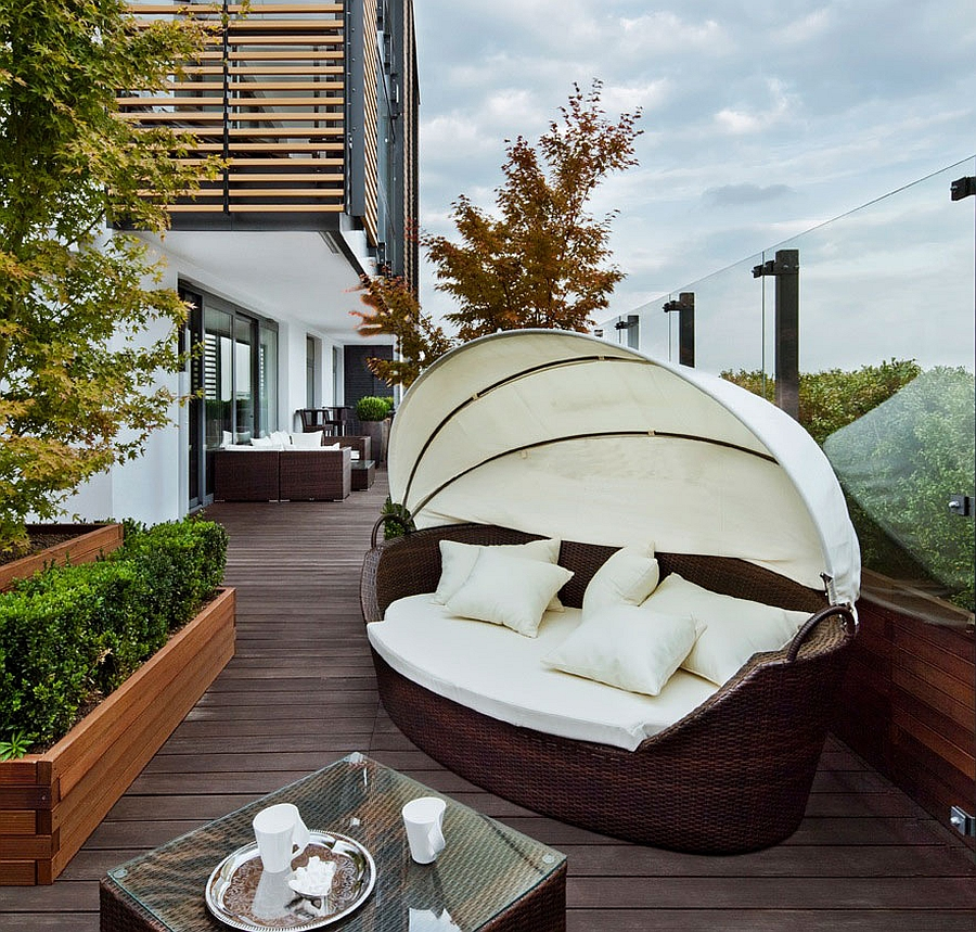 Outdoor Daybed on the Stylish Wooden Deck of the Warsaw Apartment
