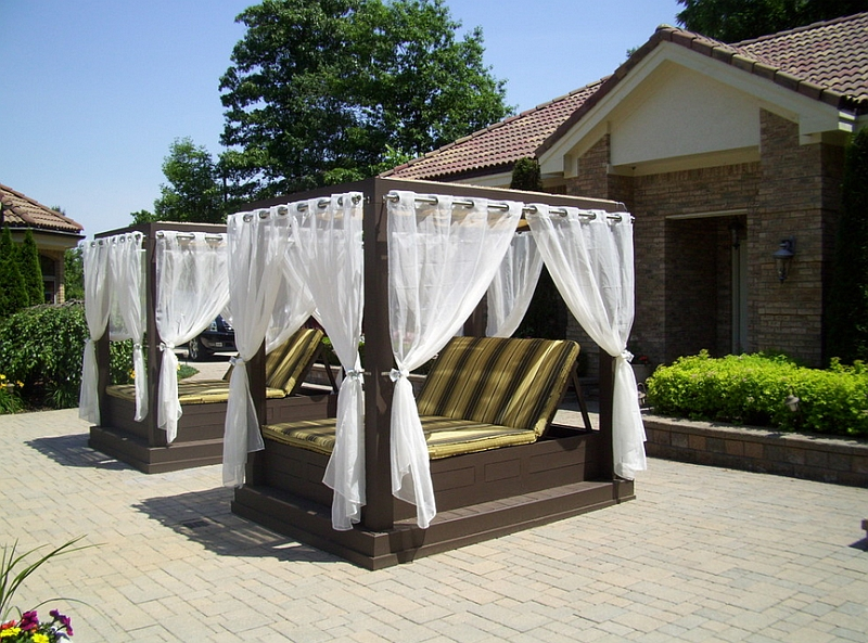 Twin Poolside Canopy Beds Enhancing Summer Evenings