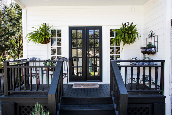 Beautiful Boston Ferns on the Front Porch Enhancing the Contrasthite Between Black and White
