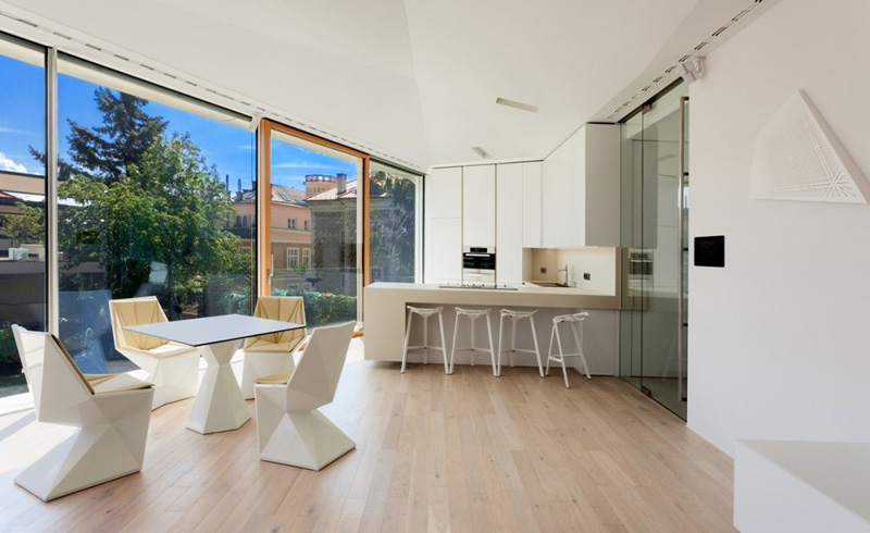 kitchen and dinning area of the Home Spa Extension- Relaxing and Rejuvenating Attractor by architekti.sk