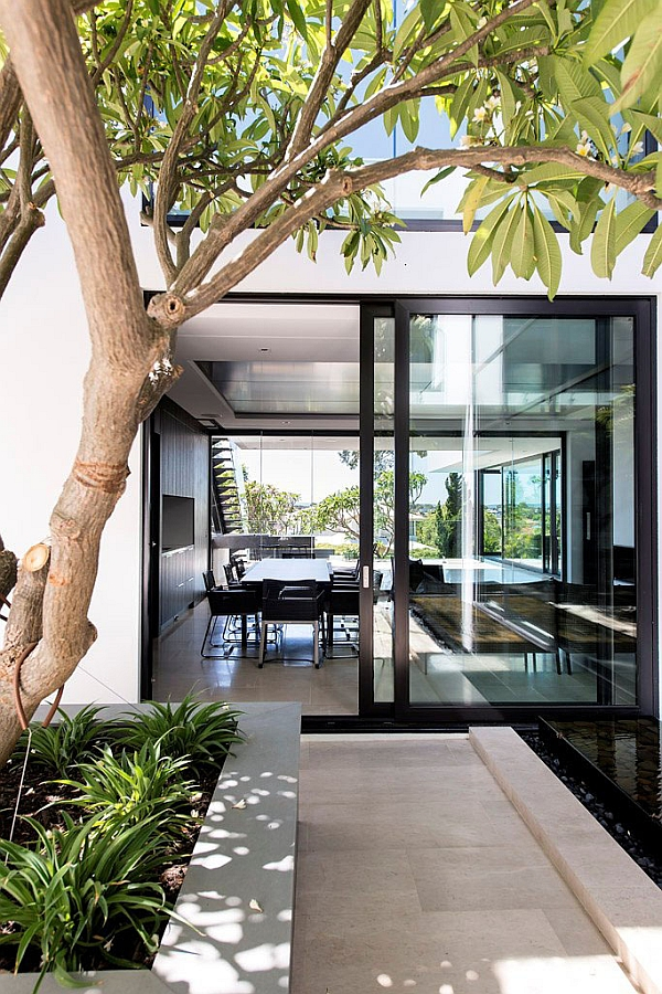 Full Height Sliding Glass Doors Connecting the Dinning Area with the Backyard