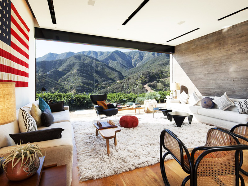 living room with wall glazed windows offering expansive views