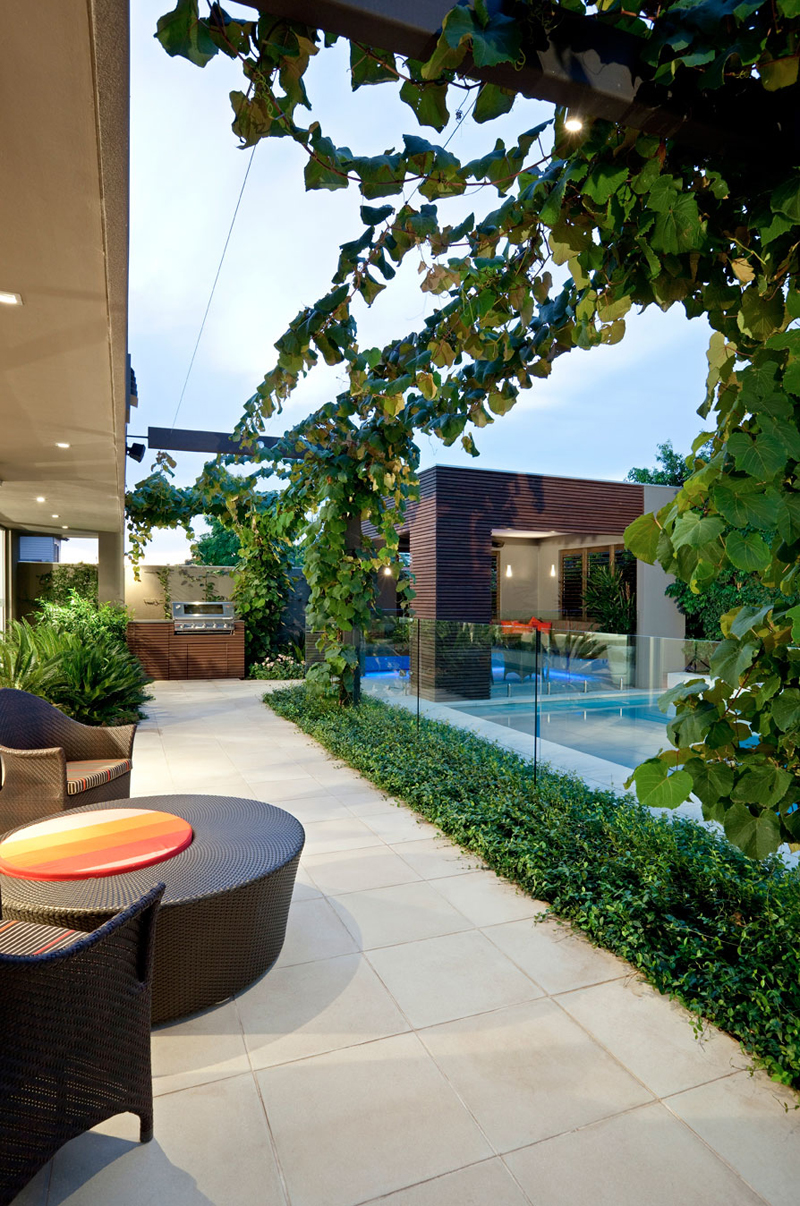 exposed pergola and terrace to a swimming pool