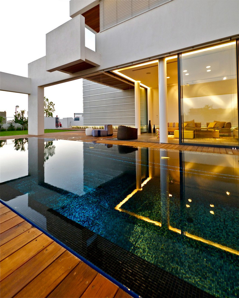 minimalist modern mansion reflected in the swimming pool