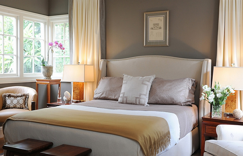Simple Bedroom with Gray Walls and Drapes in Cream Glowing Beautifully