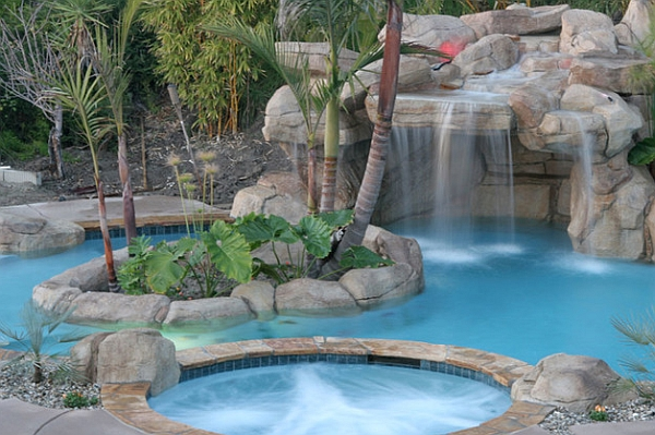 Simple Hot Tub Positioned Above the Swimming Pool Glancing at the Waterfall