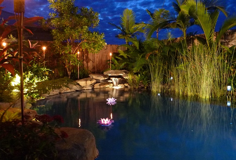 Brilliant LED Lighting Enhancing a Natural Pool Magnificently