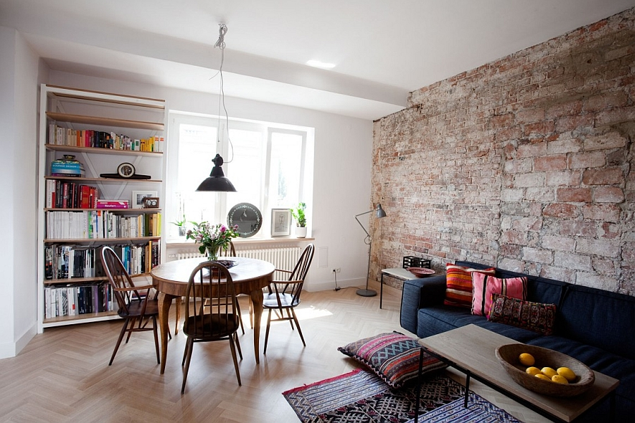 Exposed Brick Wall Adding Coziness And Warmth Through Texture In The Living Room