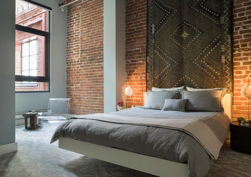 Exposed-bricks-wall-and-carpet-above-the-floating-bed